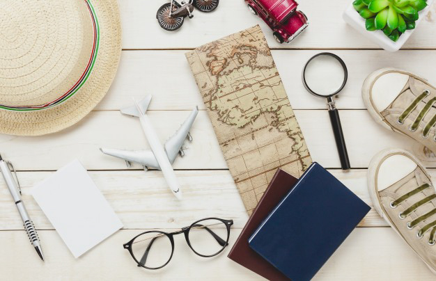 smoc_top-view-essential-travel-items-the-shoes-notebook-tree-map-pass_1921-5